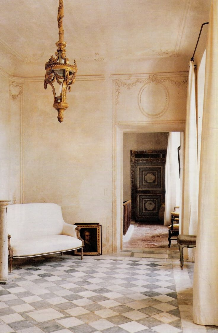 Vintage room with painted floor in black and white diamond pattern