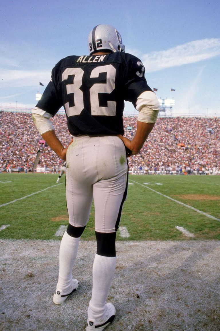 Undated: Marcus Allen #32 of the Los Angeles Raiders stands on the sidelines during a game against the Seattle Seahawks at the Los Angeles Coliseum in Los Angeles, California.