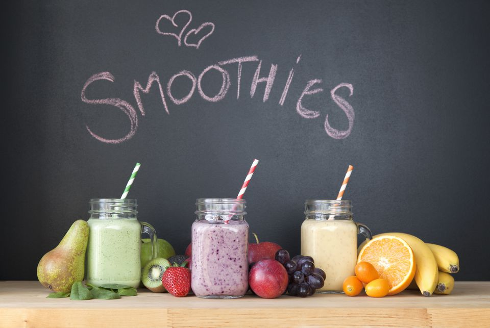 Three fresh smoothies in front of blackboard