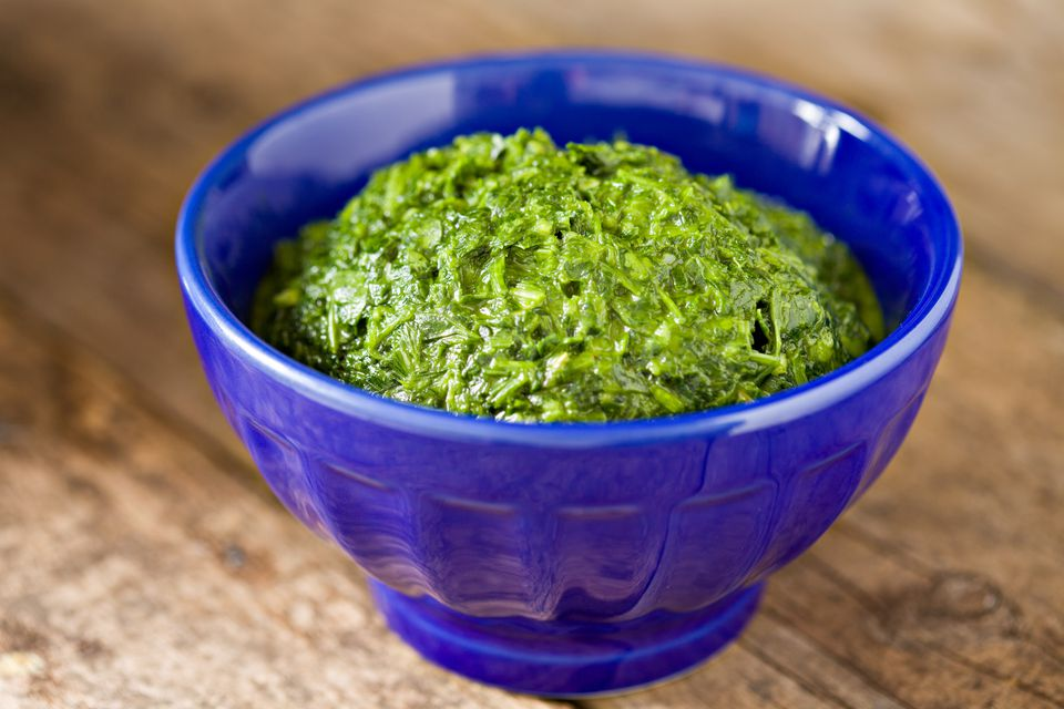 Traditional argentinian food recipes side dishes and sauces chimichurri in a blue bowl forumfinder Choice Image
