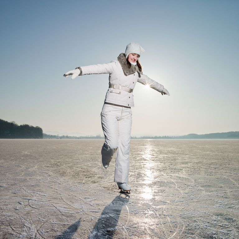 An Ice Skater Glides on One Foot