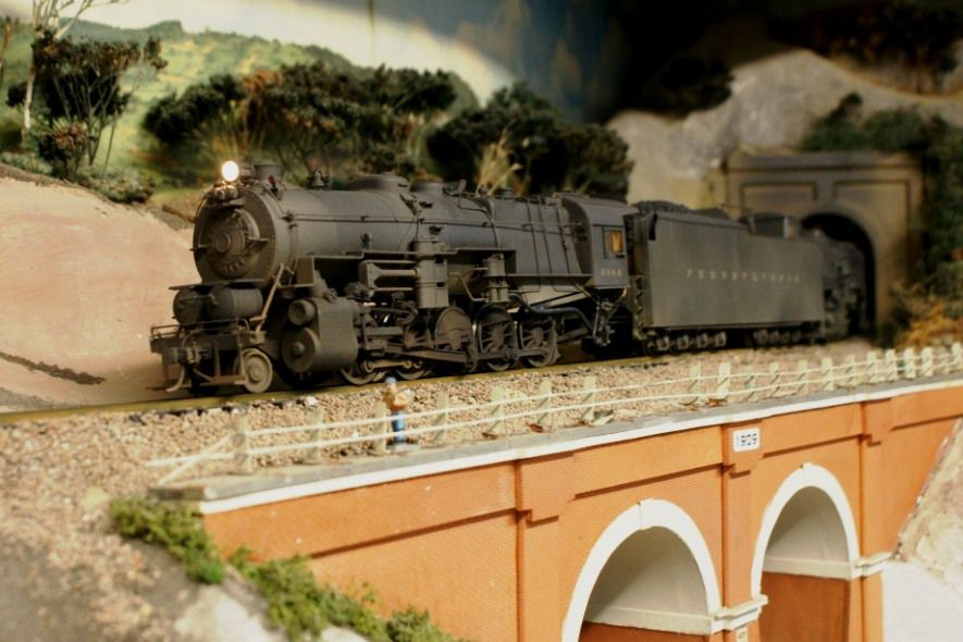 A pair of 2-rail PRR steam locomotives typify a 2-rail O layout with scale details and realistic equipment