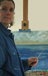Photo of Artist Marion Boddy-Evans at her easel