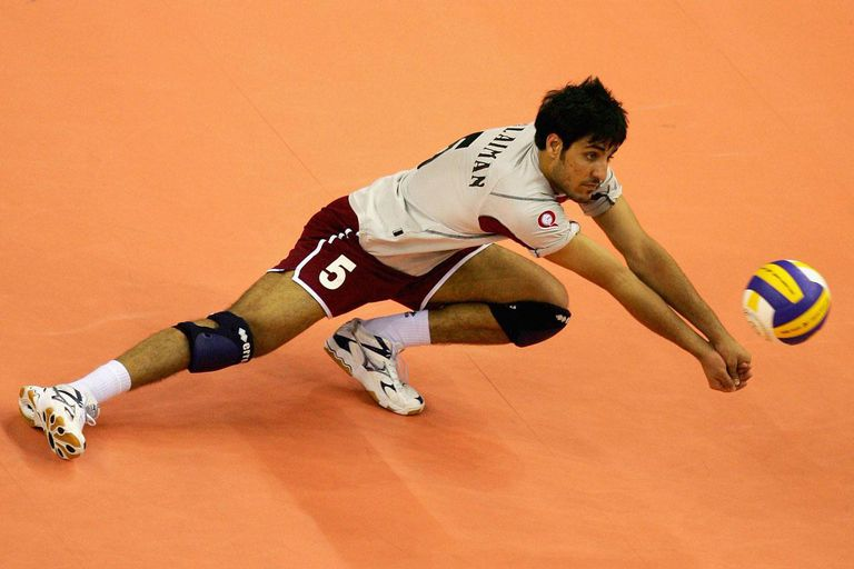 DOHA, QATAR - DECEMBER 14: Sulaiman Saad of Qatar digs the ball in the Men's Bronze Medal Volleyball Match against Saudi Arabia during the 15th Asian Games Doha 2006 at Al-Rayyan Indoor Hall on December 14, 2006 in Doha, Qatar. Saudi Arabia defeated Qatar 3-2 to win the Bronze Medal.