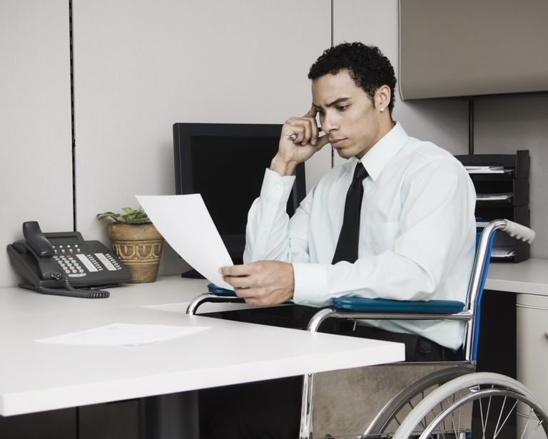 Mixed Race businessman in wheelchair