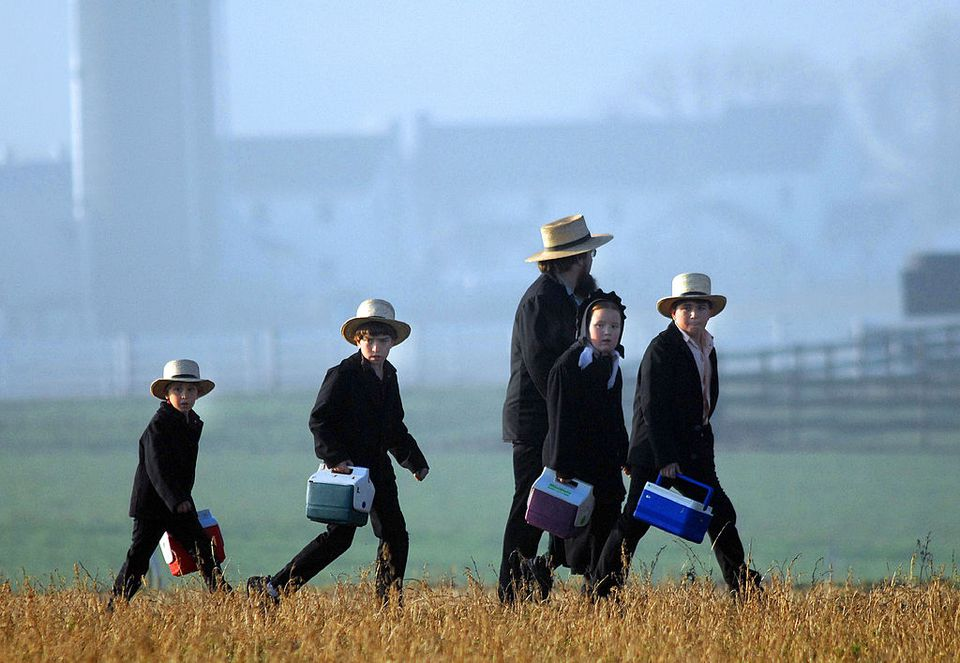 Amish children head to their newly built schoolhouse April 2, 2007 in Nickel Mines, Pennsylvania.