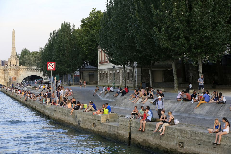 Lazing by the river is a favorite Sunday activity in Paris.