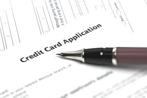 How a credit card application affects your credit score closeup of a credit card application reheart Images