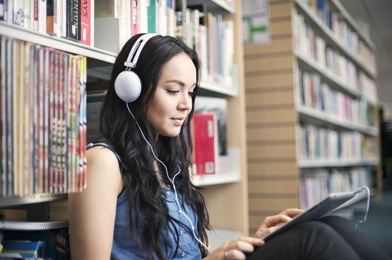 college student studying with headphones