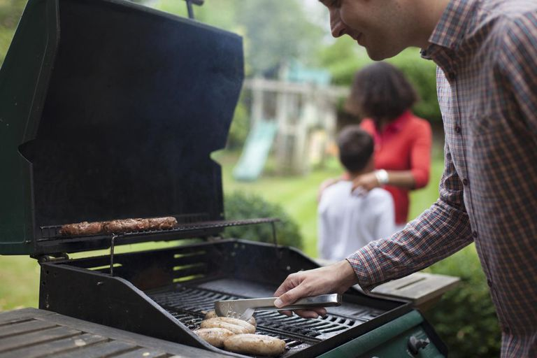 Man cooking on a barbeque