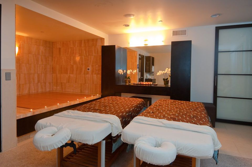A couples room with two massage tables at Tikkun Holistic Spa, Santa Monica