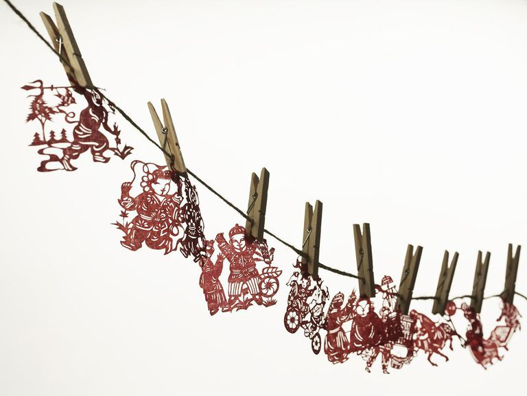 Red paper cuttings hung on washing line