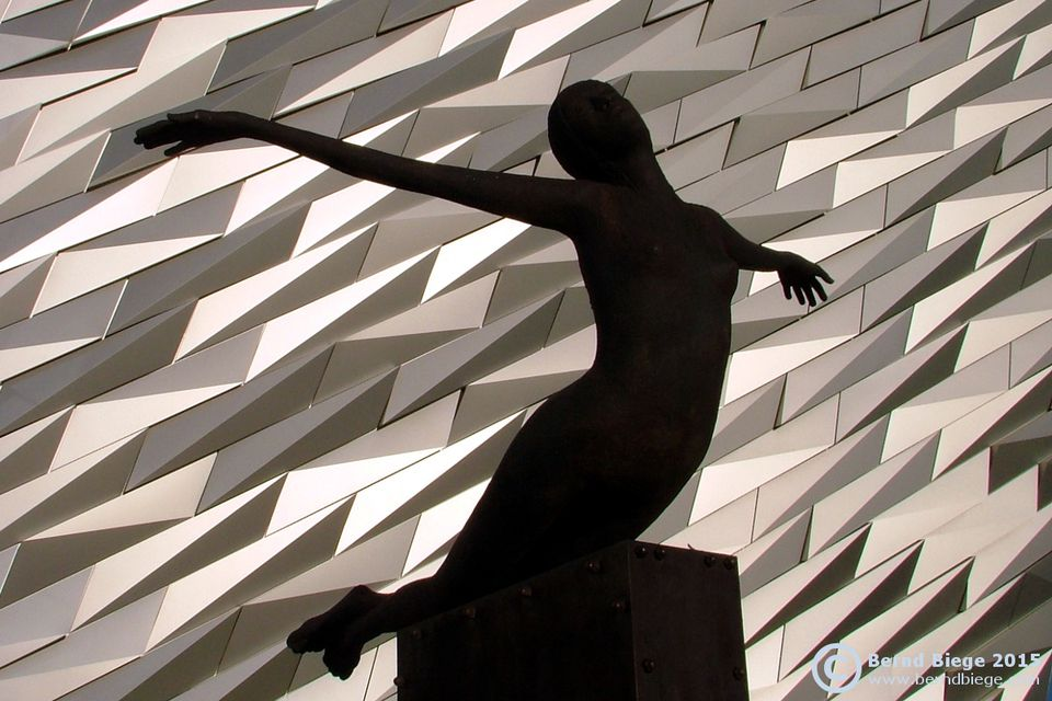 Rowan Gillespie's sculpture Titanica in front of Titanic Belfast