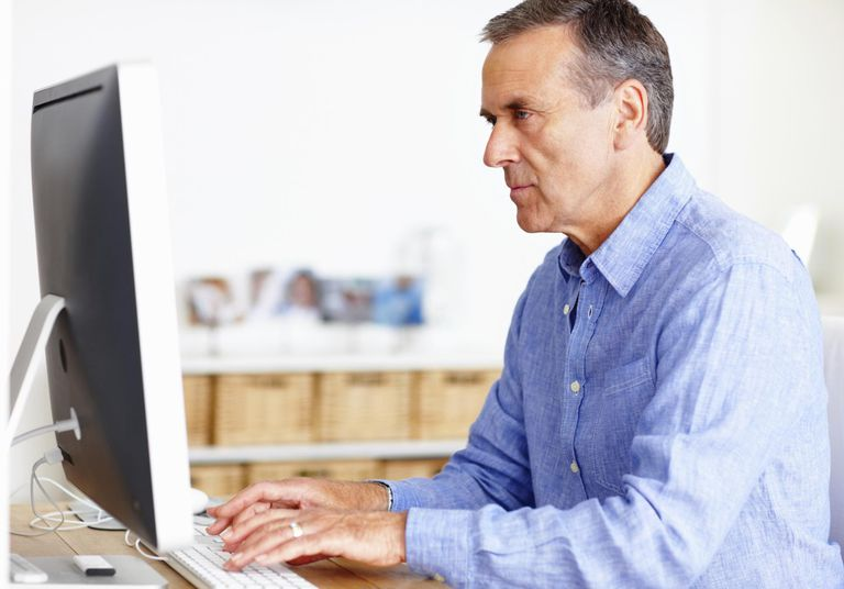 Mature man working on computer at home