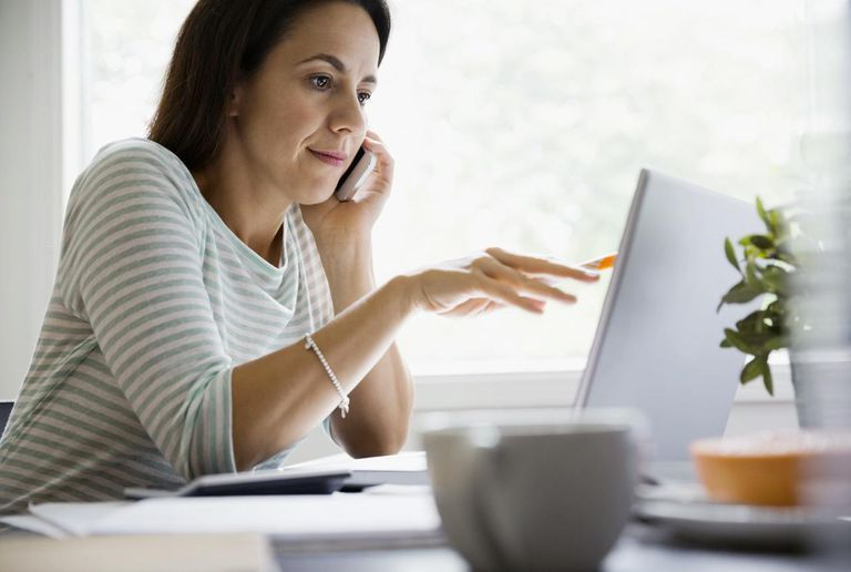 Woman using computer in home office