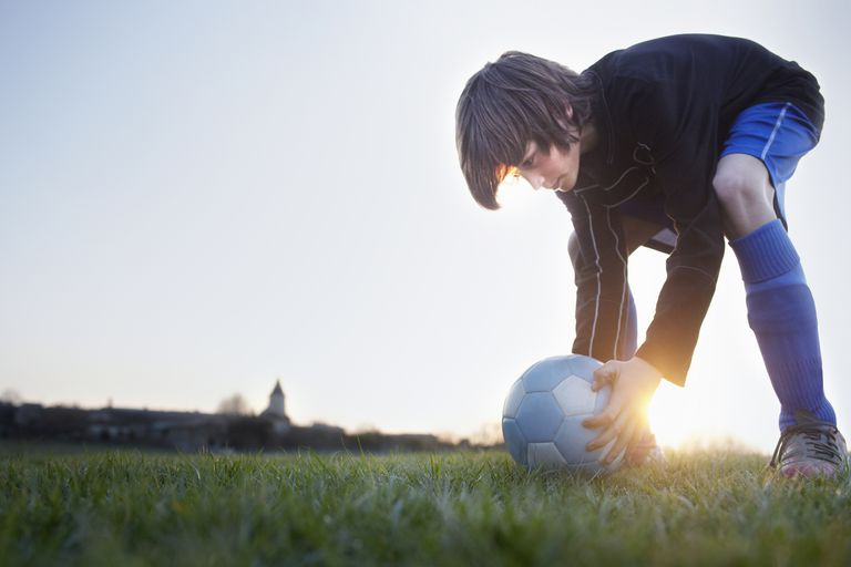 Young boy playing soccer.
