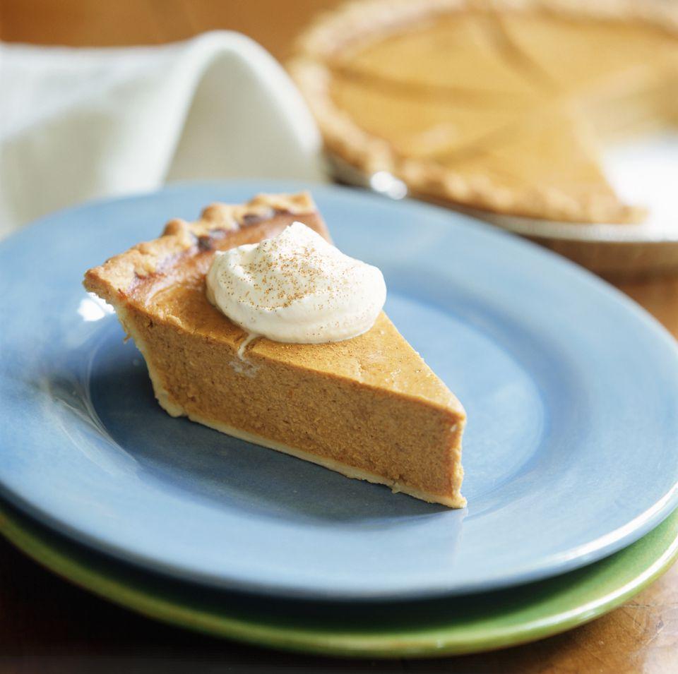 A piece of pumpkin pie with cream (USA)
