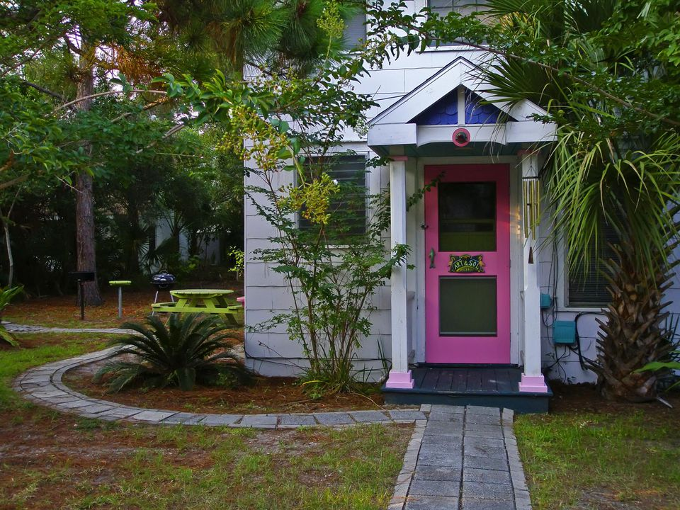Pink front door of beach cottage