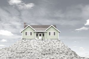 house on heap of money