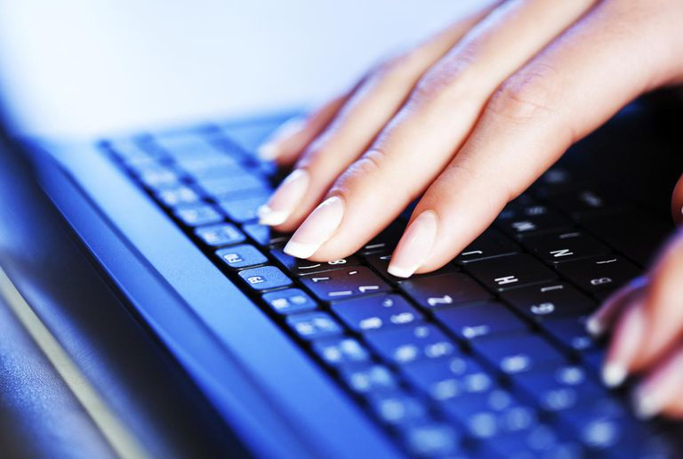 Female typing on laptop computer
