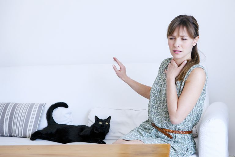 Allergic woman to cats.