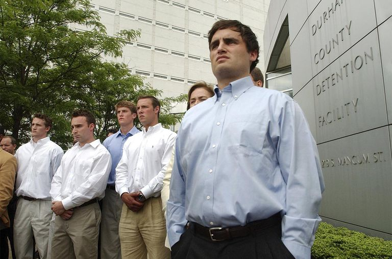 David Evans (R), 23-years-old, stands alongside fellow teammates during a media conference outside the Durham County Detention Center after being indicted on sexual assault charge
