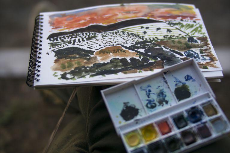 Landscape watercolor painting in sketchbook