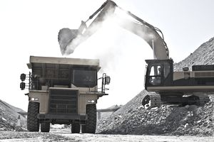 Digger and truck working in quarry