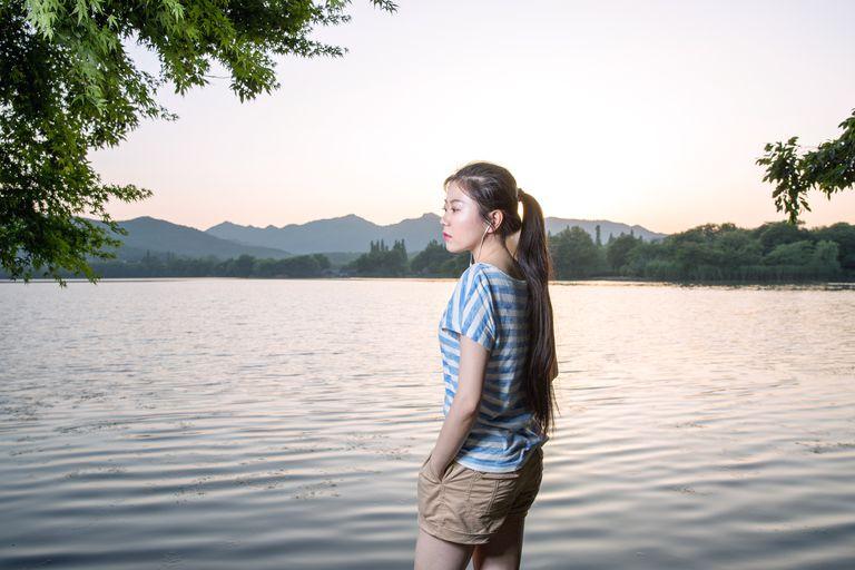 Student overlooking lake
