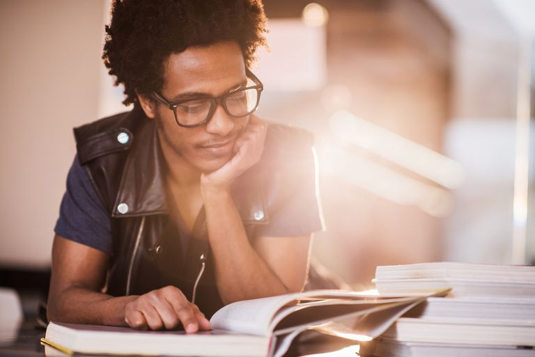 Smiling African American young man studying.