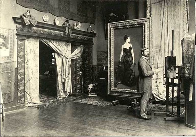 John Singer Sargent in his Paris studio, with the painting, Madame X. Sargent faces the painting The Breakfast Table, 1884, in progress.
