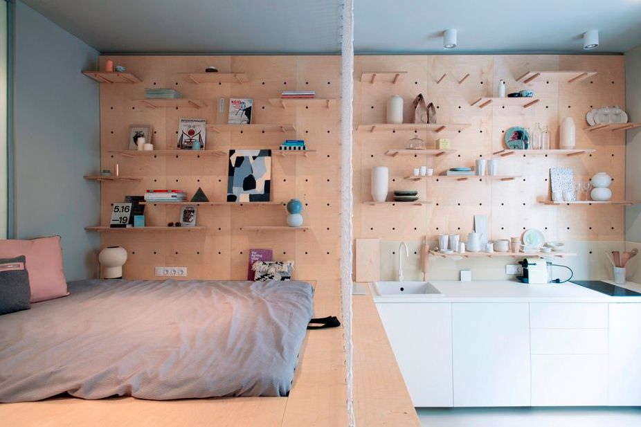 This Studio Apartment Has A Beautiful Peg Board Storage Wall