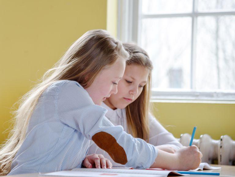 Schoolgirl helping her friend