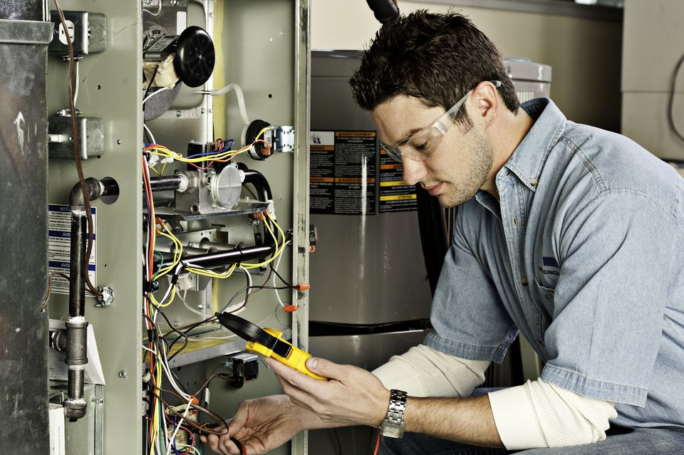Service technician testing a furnace.