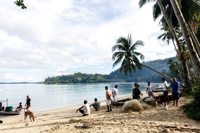 fishermen on island beach