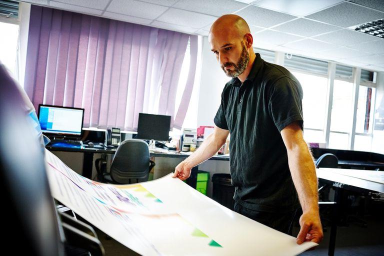 Man checking the printing quality