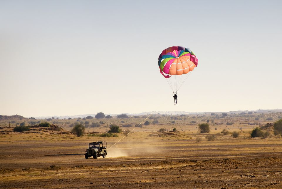 Jeep-pulled parasailing in the desert, Rajasthan.