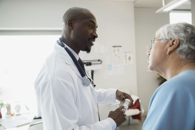 Doctor speaking with patient who has thyroid condition