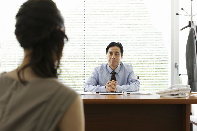 Man interviewing young woman