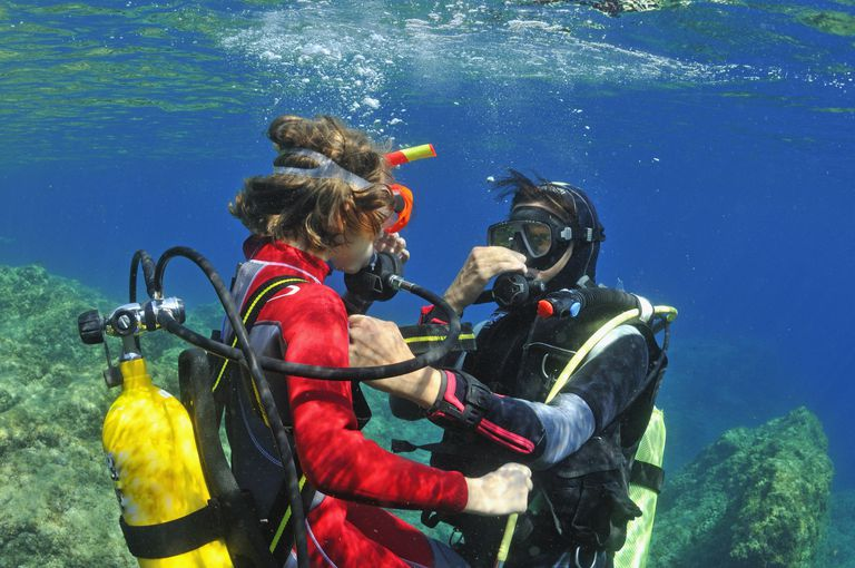 Girl (aged 9) with her scuba diving instructor underwater, Mediterranean Sea, Marseille, France, Europe