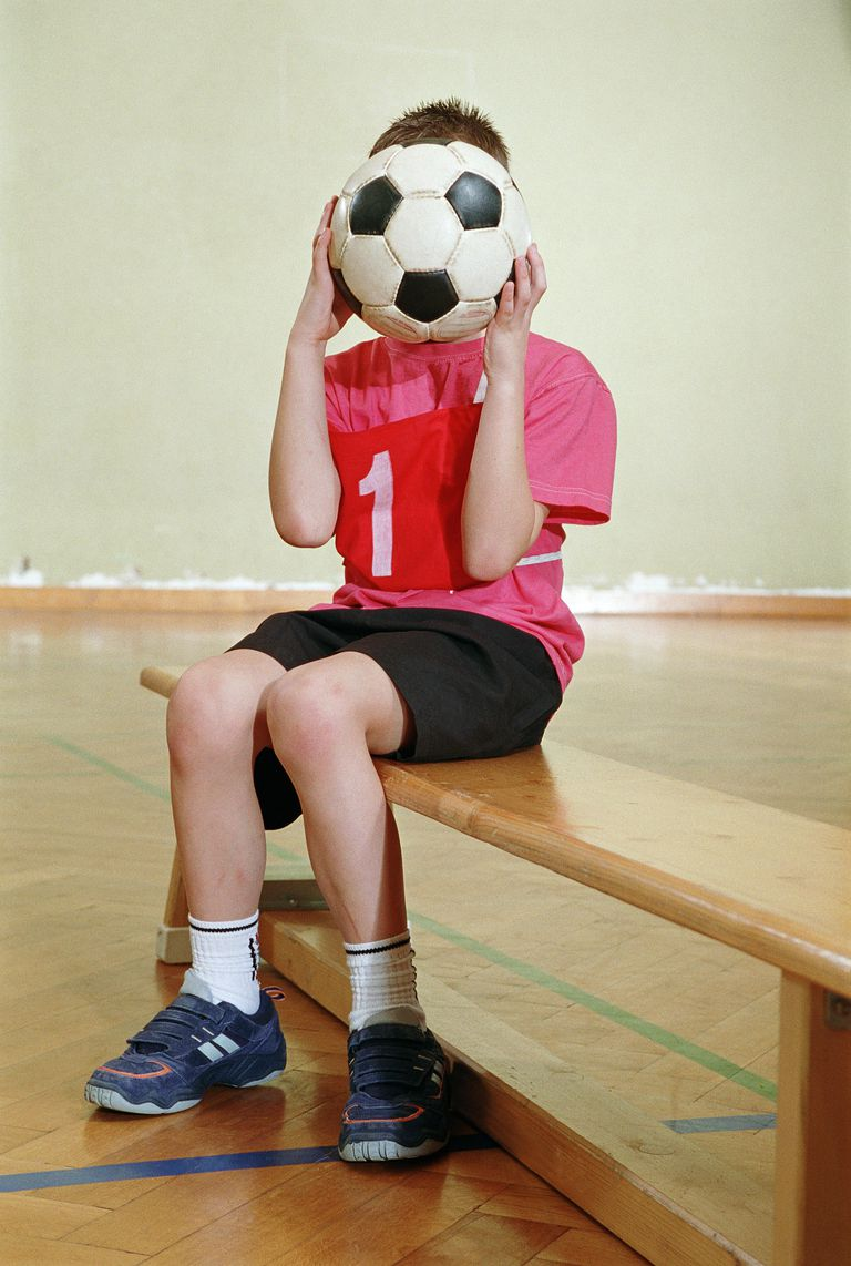 soccer ball in front of face