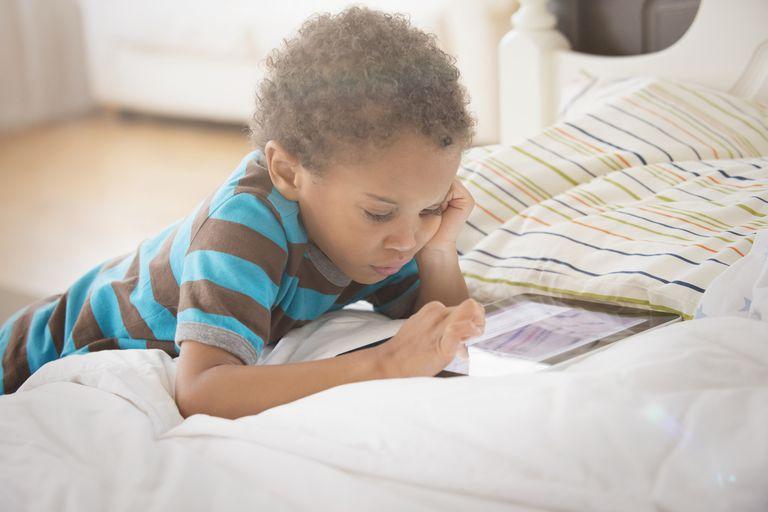 Young boy looking at digital tablet