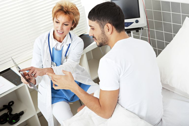 Female doctor explaining MR exposure to a male patient