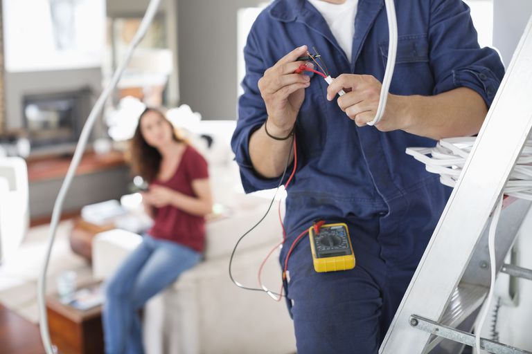 Electrician working in living room
