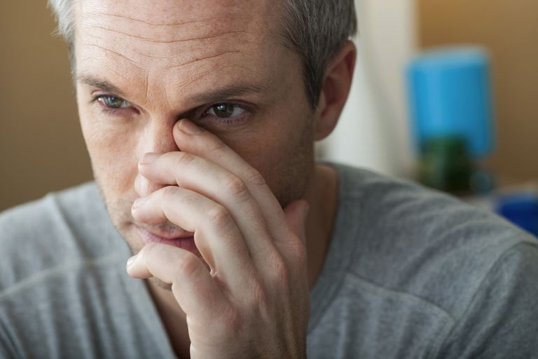Man with sinusitis at home