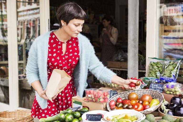 Woman selecting tomatoes