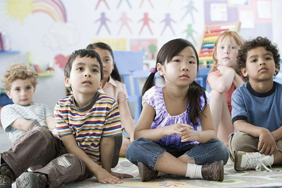 Children sitting on a floor
