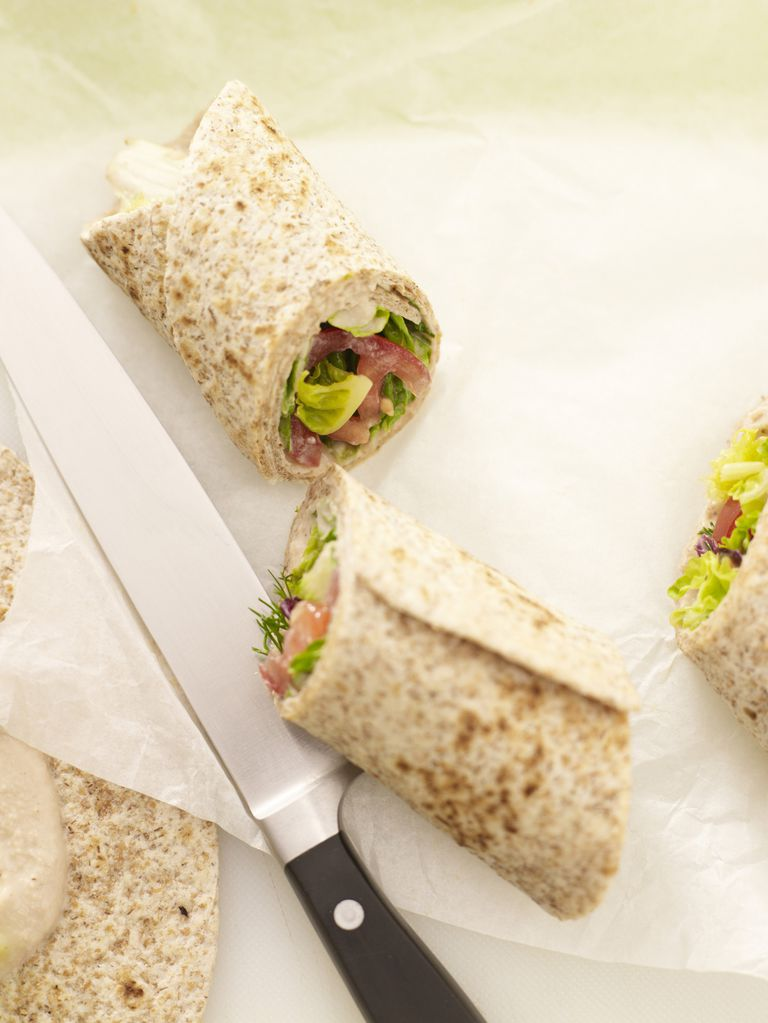 Wraps with salad and tuna spread filling, close up