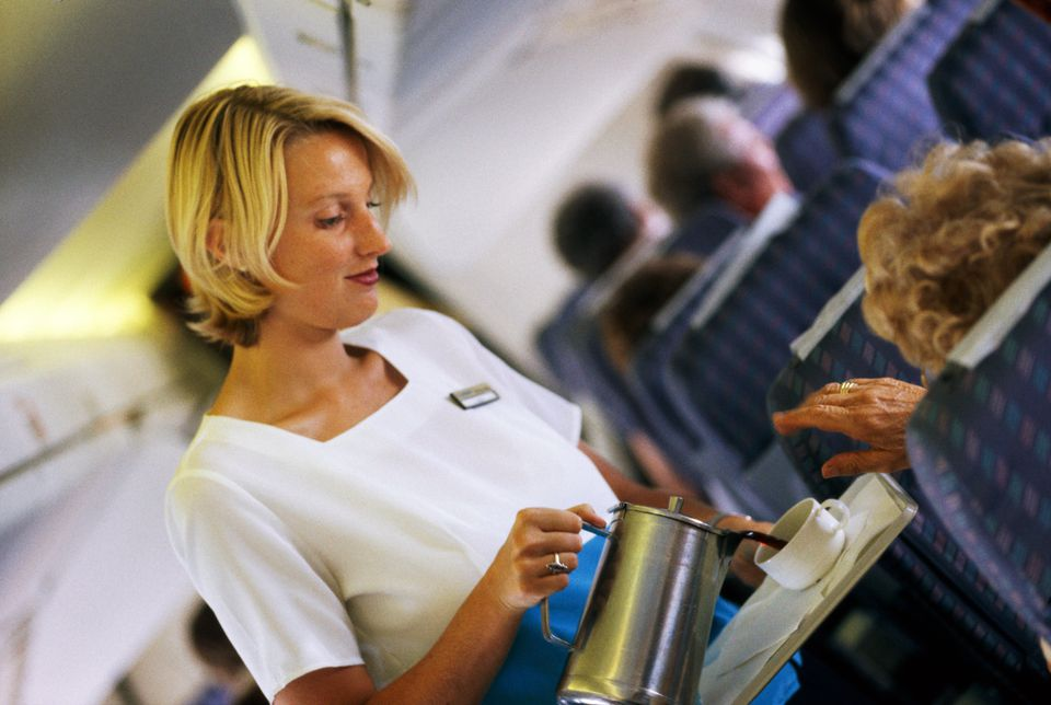 AIR HOSTESS, FLIGHT SERVING DRINK