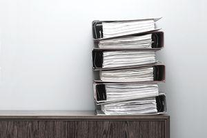 stacked binders of paperwork